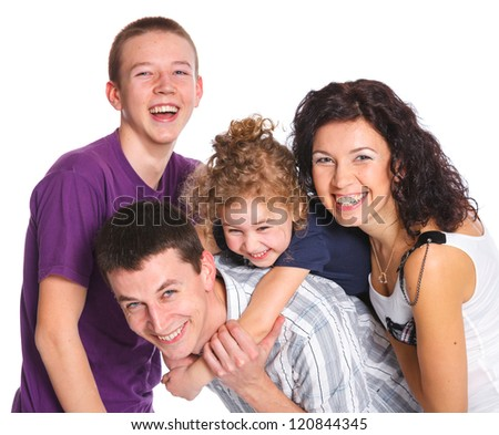 Portrait of beautiful smiling happy family of four - isolated over a white background