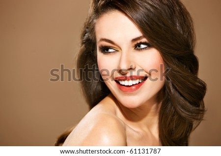 Portrait of beautiful smiling woman isolated on beige with copyspace