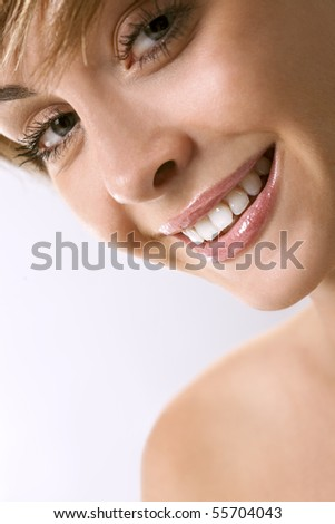 Portrait of beautiful smiling woman isolated over a white background