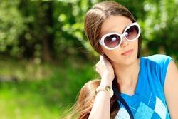 Portrait of beautiful summer girl outdoor.