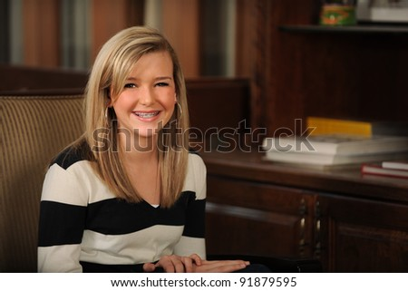 Portrait of beautiful teen girl with braces smiling inside home