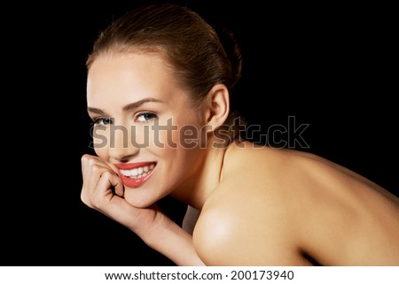 Portrait of beautiful topless caucasian woman. Spa concept. On black backround.