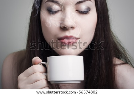 Portrait of beautiful woman drinking coffee