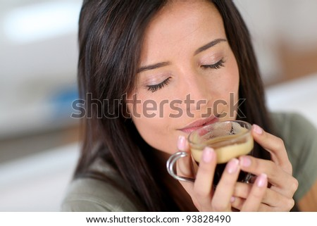 Portrait of beautiful woman drinking expresso - stock photo