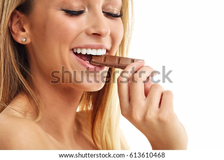 Portrait of beautiful woman holding chocolate bar #613610468