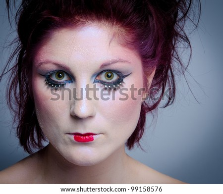 Portrait of beautiful woman in ice queen makeup