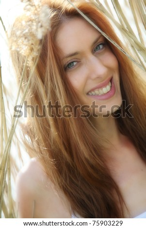 Portrait of beautiful woman in natural background