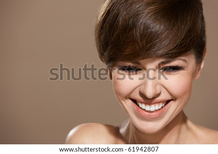 Portrait of beautiful woman isolated on beige looking at copyspace