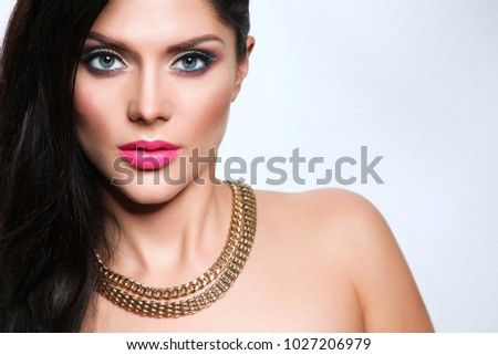 Portrait of beautiful woman, isolated on gray background. Portrait of beautiful woman