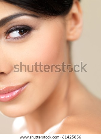Portrait of beautiful woman looking on her left