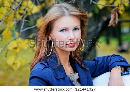 Portrait of beautiful woman on a background nature of autumn