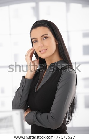 Portrait of beautiful woman on call, using cell phone, smiling.?