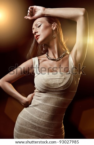 Portrait of beautiful woman on dark background - stock photo