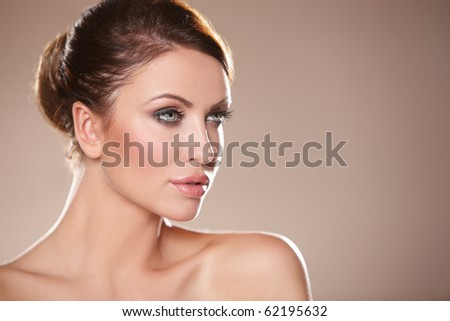 Portrait of beautiful woman on natural background