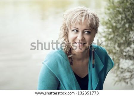 Portrait of beautiful woman on nature