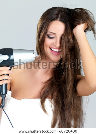 Lifestyle - Pagina 5 Stock-photo-portrait-of-beautiful-woman-she-holding-hair-dryer-60720430