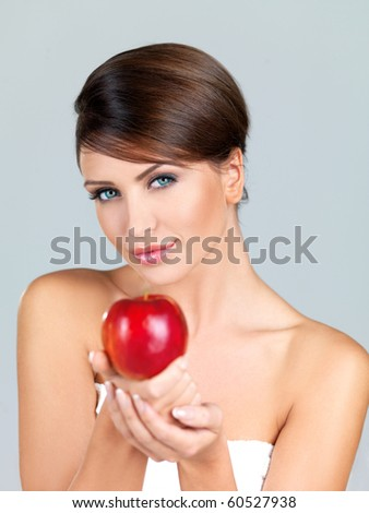 Portrait of beautiful woman, she holding red apple