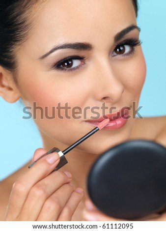 Portrait of beautiful woman she is doing makeup