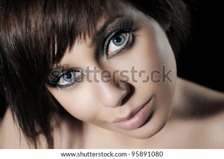 Portrait of beautiful woman, she is isolated on black