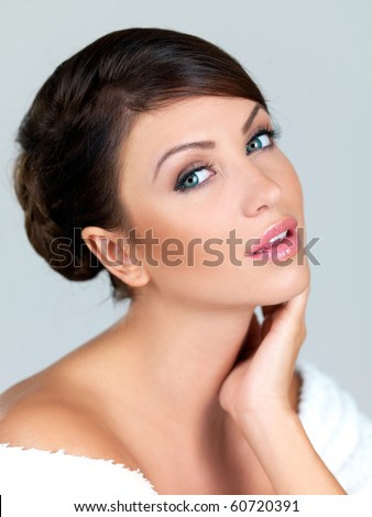 Portrait of beautiful woman, she is isolated on grey