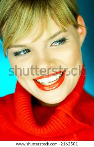 Portrait of beautiful woman wearing red sweater