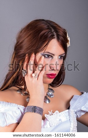 portrait of beautiful woman wearing rings and necklace