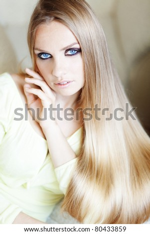 Portrait of beautiful woman with amazing shining blond hair
