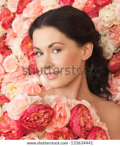 portrait of beautiful woman with background full of roses
