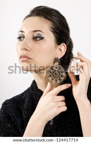 Portrait of beautiful woman with beautiful make-up and expensive earrings.