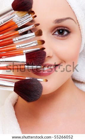 portrait of beautiful woman with brushes for make-up