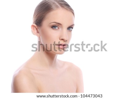 Portrait of beautiful woman with clean face over white background