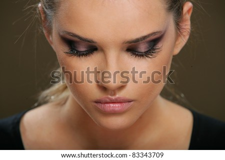 Portrait of beautiful  woman with closed eyes,  isolated on gray. Fashion Makeup