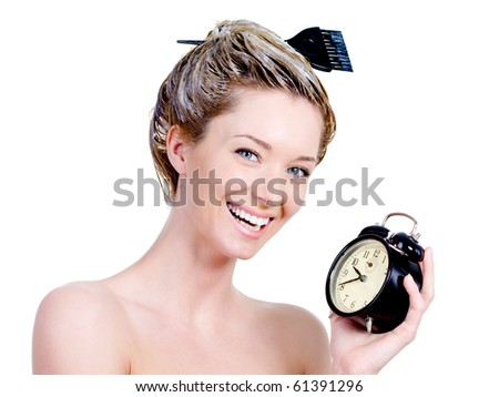 Portrait of beautiful woman with dye on a hair and holding clock - isolated on white