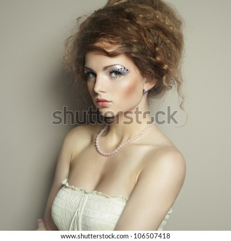 Portrait of beautiful  woman with elegant hairstyle. Fashion photo - stock photo