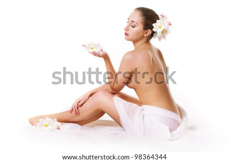 Portrait of beautiful woman with flowers on white - stock photo