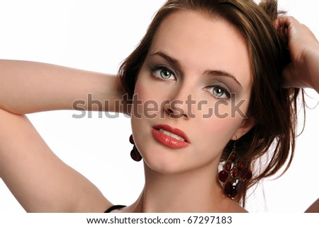 Portrait of beautiful woman with hands behind head isolated over white background