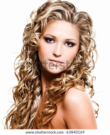 Portrait of beautiful woman with luxury blonde long hair