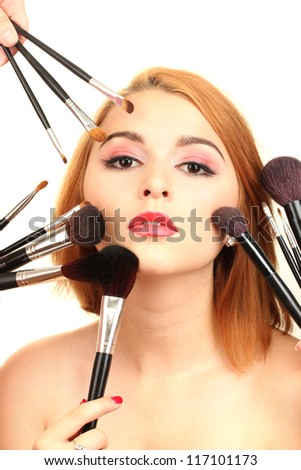 portrait of beautiful woman   with make-up brushes