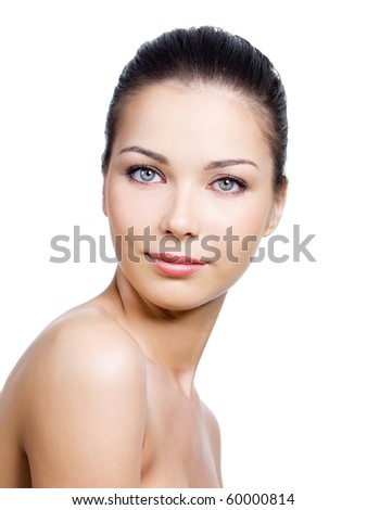 Portrait of beautiful woman with pretty face with clean skin on it - white background