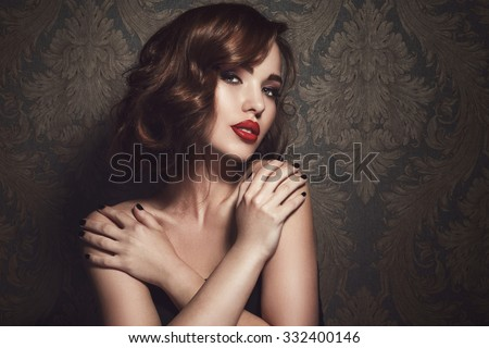 Portrait of beautiful woman with red lips