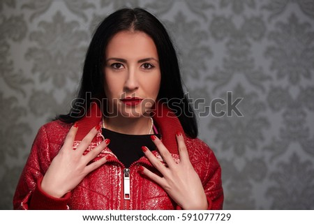Portrait of beautiful woman with red nails. #591077729