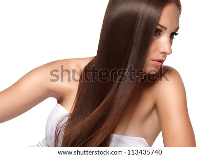 Portrait of Beautiful Woman with smooth gloss long hair. High quality image.