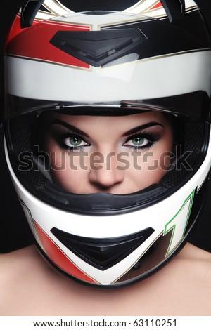Portrait of beautiful woman with stylish makeup in biker helmet