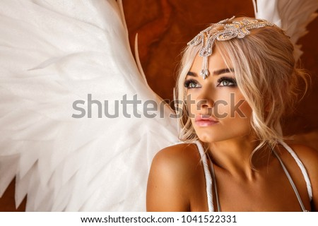 Stock Photo portrait of beautiful woman with white angel wings on