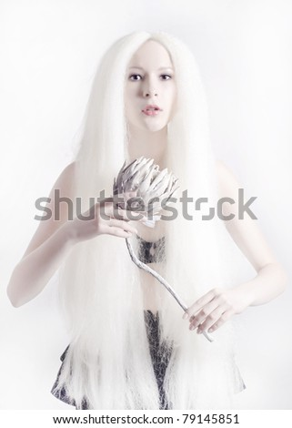 Portrait of beautiful woman with white hair and flower
