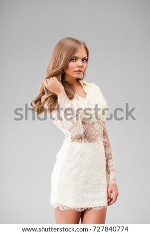 Portrait of beautiful young adult attractive sexy and sensuality happy smiling pretty blonde woman in white dress isolated on gray background #727840774