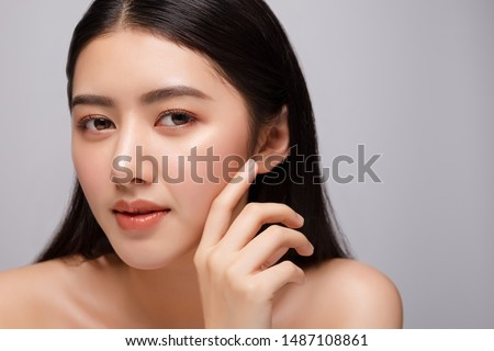 Portrait of beautiful young asian woman clean fresh bare skin concept. Asian girl beauty face skincare and health wellness, Facial treatment, Perfect skin, Natural make up. Isolated on gray background