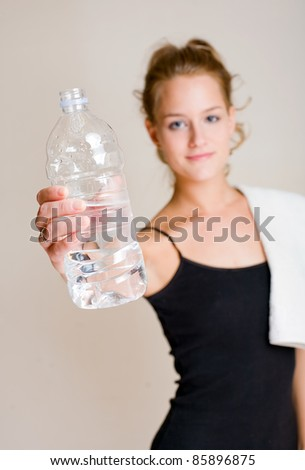 Portrait of beautiful young blond woman offering water.
