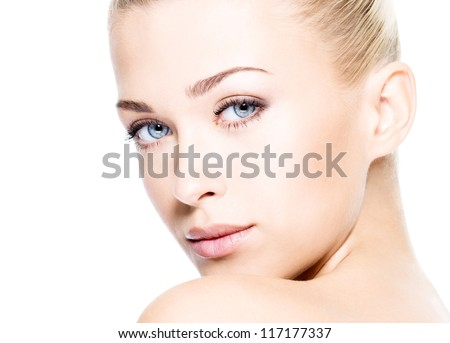 Portrait of beautiful young blond woman with clean face.  High key shot.