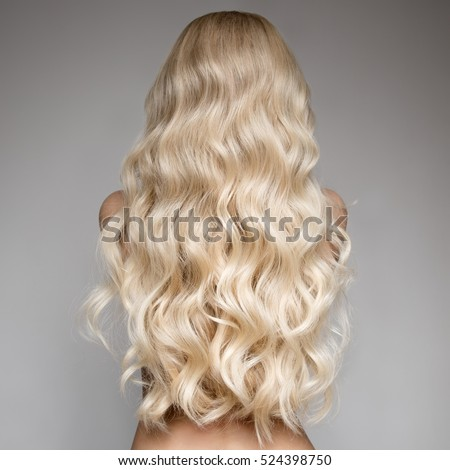 Shutterstock Portrait Of Beautiful Young Blond Woman With Long Wavy Hair. Back View